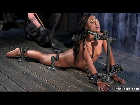 Hanged for ankles ebony Chanell Heart gets her hot ass whipped then on the floor laid with back bend on the floor in device bondage gets ass caned