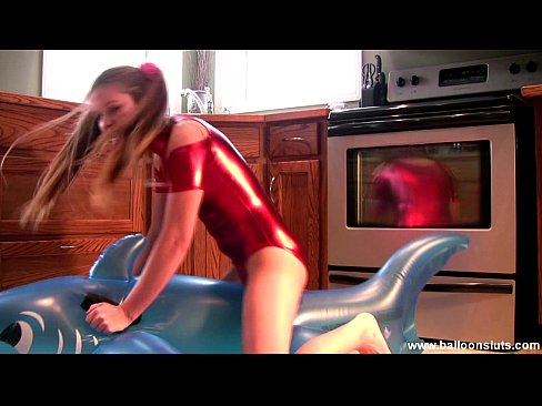 Megan in Shiny Spandex masturbating with Inflatable Whale
