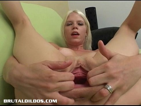Blonde bomshell kathy fills her pussy with a massive dildo 5