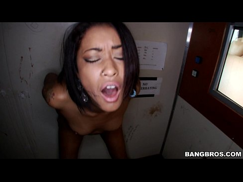 Black Slut Fucks in the Glory Hole
