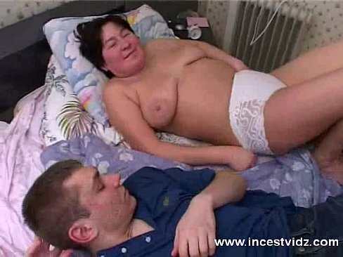 sleeping mature mom and son on bed
