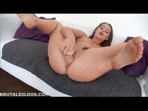 Insatiable girl is often using a huge dildo