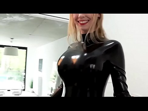 Blonde in rubber suit bouncing boobs