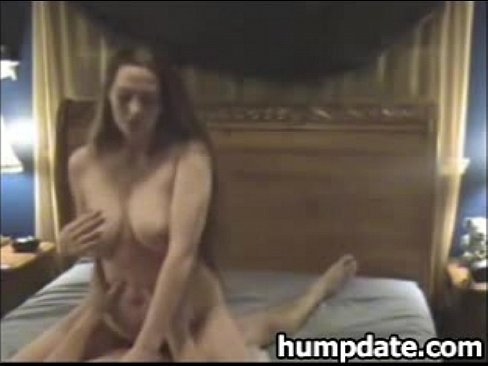 Aiden beautiful brunette with long hair and natural tits stroking tits