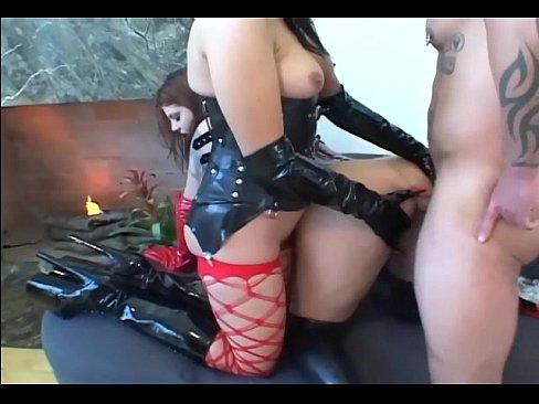 Fetish babes in latex and stockings share a cock
