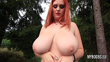 Redhead Alexsis Faye Takes Off Bra And Plays With Her Big Boobs In The Forest