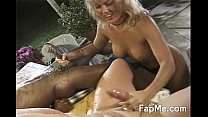 Hot MILF gives head to two horny guys thumbnail