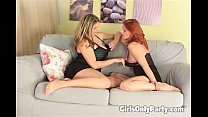 Two hot girls play with a massive dildo