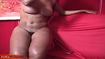 Black tranny with decent tits tugs her girl rod on red sofa