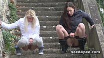 Girlfriends taking off pants to piss in public