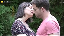 Mom And Son Enj oy Together In Natural Surroun Natural Surroundings Outdoors