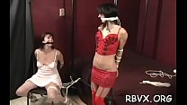 Mature wench gets titillated while being belted tight