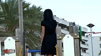 Cute young girl peeing her panties on a public beach thumbnail