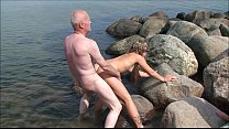 Grandpa Ulf Larsen, 54, fuck two 19-year old teen whores on public beach