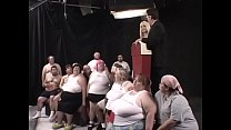 Two dozens of lard-asses suck, lick and fuck each other during The Worlds First 300 Lb Gang Bang, organized by ingenious beauty Kat Kleevage
