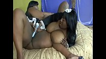 Two huge black whores in maid costumes do some muff diving in bed
