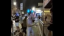Young man strips naked and walks the downtown streets