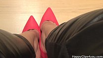 Red high heels shoe dangling