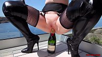 Mature Red XXX fucks a champagne bottle outside video