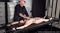 Amateur slave Louise in dungeon rack bondage and hot wax tit punishments video