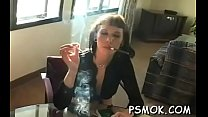 Gorgeous hottie sucks a dick like a pro while smoking a cig