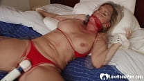 MILF gets toyed with a Hitachi on camera