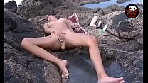 Girl On The Rocks By The Sea Masturbates And Has A Big Dildo In Anal