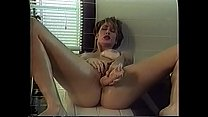 Blonde with a shaved pussy gets horny in the bathroom and masturbates solo