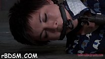 Clamped babe gets her fuck holes pounded with toys