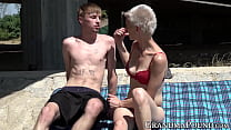 Pixie grandma swallows young cock beneath bridge Thumbnail