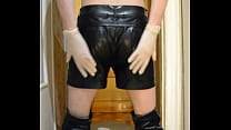 Guy In PVC Bra And Leather Shorts