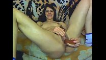 Satisfying Herself With Dildo Before Webcam