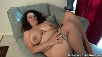 American milf Nicolette Parsons rubs her hungry cunt preview image