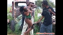 Enchained African babe gets abused by two horny... thumb