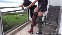 Naughty wife pissed on by some guys on the balcony