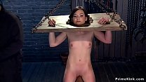 Brunette slave is set on wooden horse