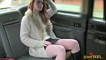 Scandalous redhead darling flashes pussy inside the cab