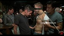 Tied up and blindfolded gay slave gets to suck strangers cock while in a bar