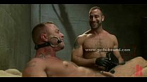 Gay slave and master dressed in leather fucking in bondage punishment sex