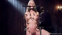 Clamped blonde Milf in device bondage