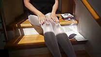 Sexy woman with sexy legs putting on 8! layers of pantyhose preview image
