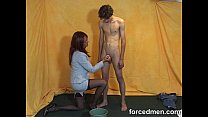 Mistress aims to shoot cum in the bucket preview image