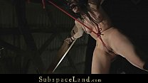 Brunette slave streched in ropes and meanly spa...