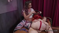 Brunette in red rope bondage gets anal