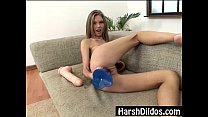 Petite blonde pounding two big dildos thumbnail