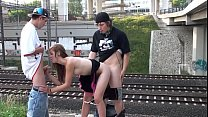 Cum in the mouth of a hot blonde teen girl in a public street sex threesome by a railway with 2 young guys doing blowjob cock sucking and vaginal penetration sexual intercourse with casual spectators watching this crazy screwing adventure