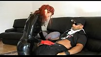 Hot redhead girl in latex seduces a worker's Thumb