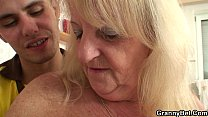 Blonde granny in stockings rides stranger's cock