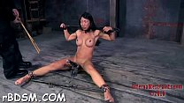 Tough hotty is gagged up and caned zealously