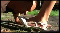 Young Girl in Heels and Hot Pants dominate a Man in a Park